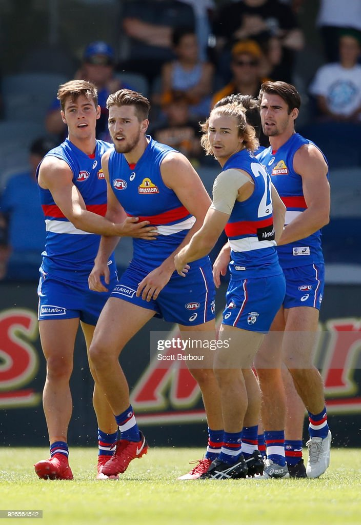 Josh Dunkley of the Bulldogs is congratulated by Marcus Bontempelli and Easton Wood of the Bulldogs after kicking a goalduring the AFL JLT Community Series match between the Western Bulldogs and the Hawthorn Hawks at Mars Stadium on March 3, 2018 in Ballarat, Australia.
