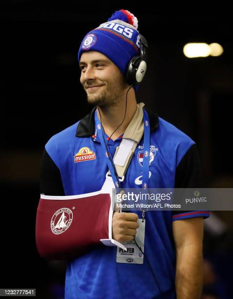Josh Dunkley of the Bulldogs is seen with his arm in a sling during the 2021 AFL Round 08 match between the Western Bulldogs and the Carlton Blues at...