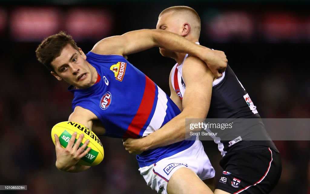 Josh Dunkley of the Bulldogs is tackled during the round 20 AFL match between the St Kilda Saints and the Western Bulldogs at Etihad Stadium on August 4, 2018 in Melbourne, Australia.