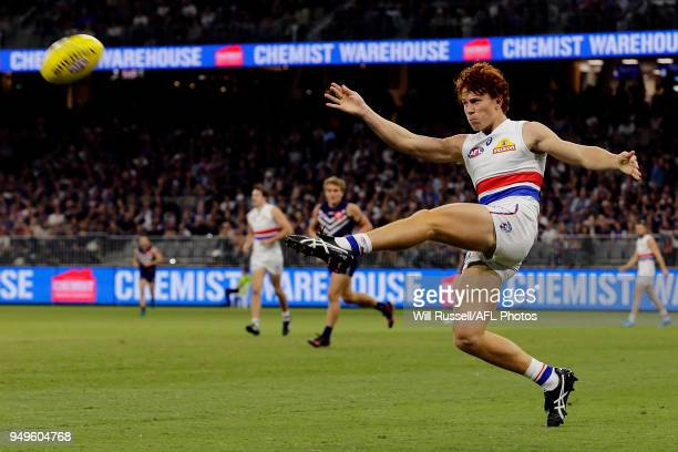 Josh Dunkley of the Bulldogs lkicks the ball during the round five AFL match between the Fremantle Dockers and the Western Bulldogs at Optus Stadium...