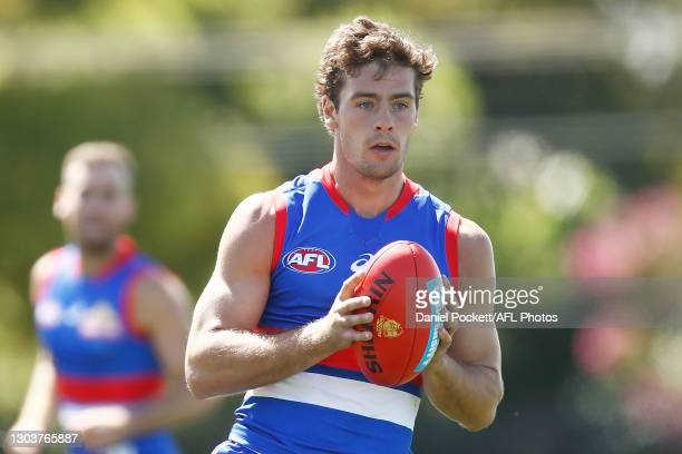 Josh Dunkley of the Bulldogs runs with the ball during the AFL Practice Match between the Western Bulldogs and the Hawthorn Hawks at Whitten Oval on...