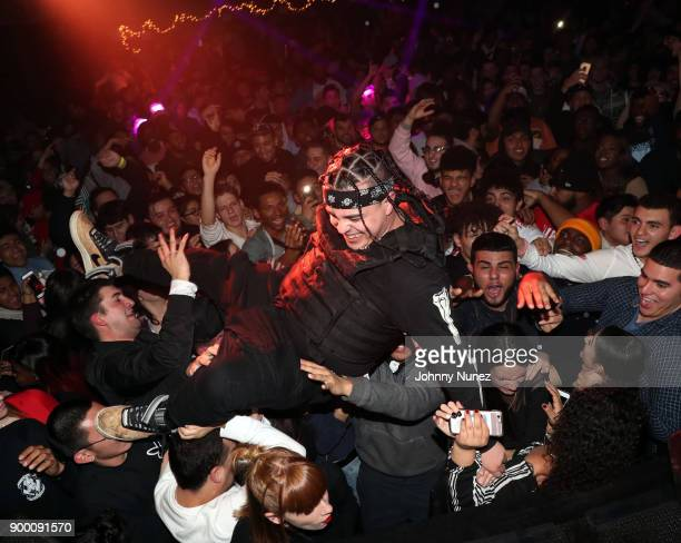 Josh DWH stagedives during his performance at FREQ NYC on December 30 2017 in New York City