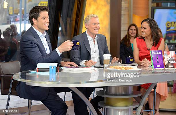 AMERICA Josh Elliott Sam Champion and Linsey Davis coanchor Good Morning America 6/20/13 airing on the Walt Disney Television via Getty Images...
