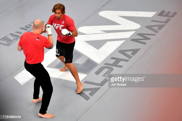 Josh Emmett and Urijah Faber perform for fans and media during the open workouts at Urijah Faber's Ultimate Fitness on July 10, 2019 in Sacramento,...
