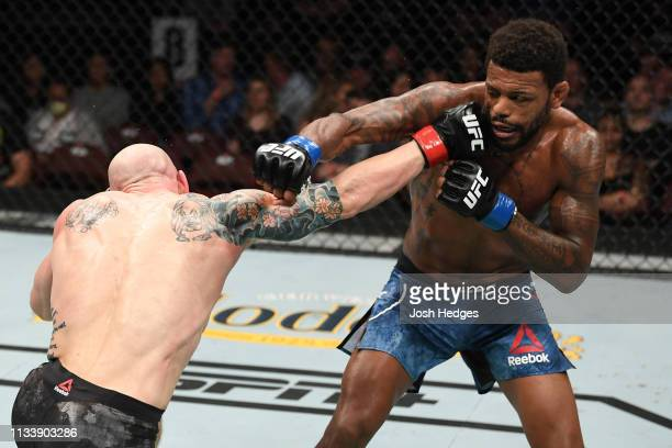 Josh Emmett punches Michael Johnson in their featherweight bout during the UFC Fight Night event at Wells Fargo Center on March 30 2019 in...