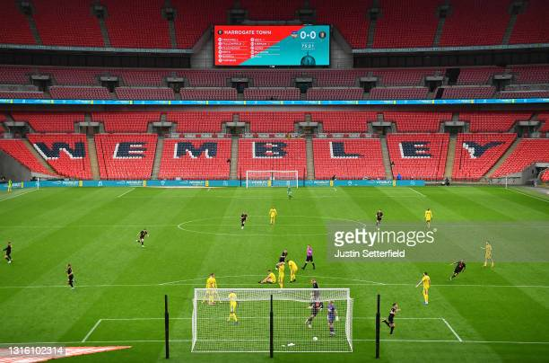 Josh Falkingham of Harrogate Town celebrates after scoring their side's first goal during the 2019/20 Buildbase FA Trophy Final between Concord...