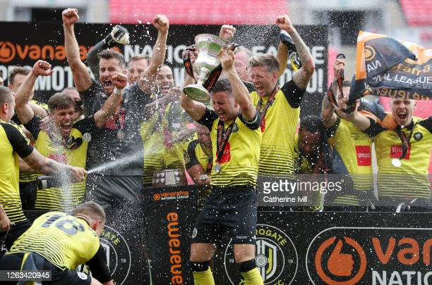Josh Falkingham of Harrogate Town lifts the trophy after his teams victory in the Vanarama National League Play Off Final match between Harrogate...