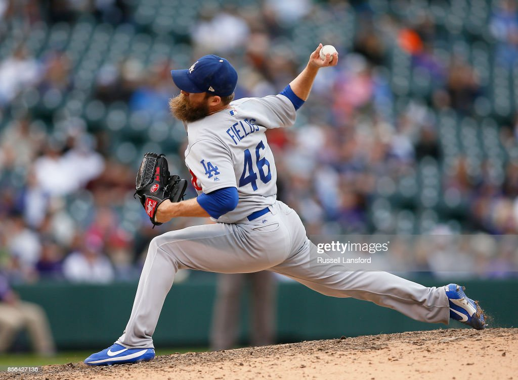 Josh Fields #46 of the Los Angeles Dodgers pitches during the ninth inning of a regular season MLB game against the Colorado Rockies at Coors Field on October 1, 2017 in Denver, Colorado.