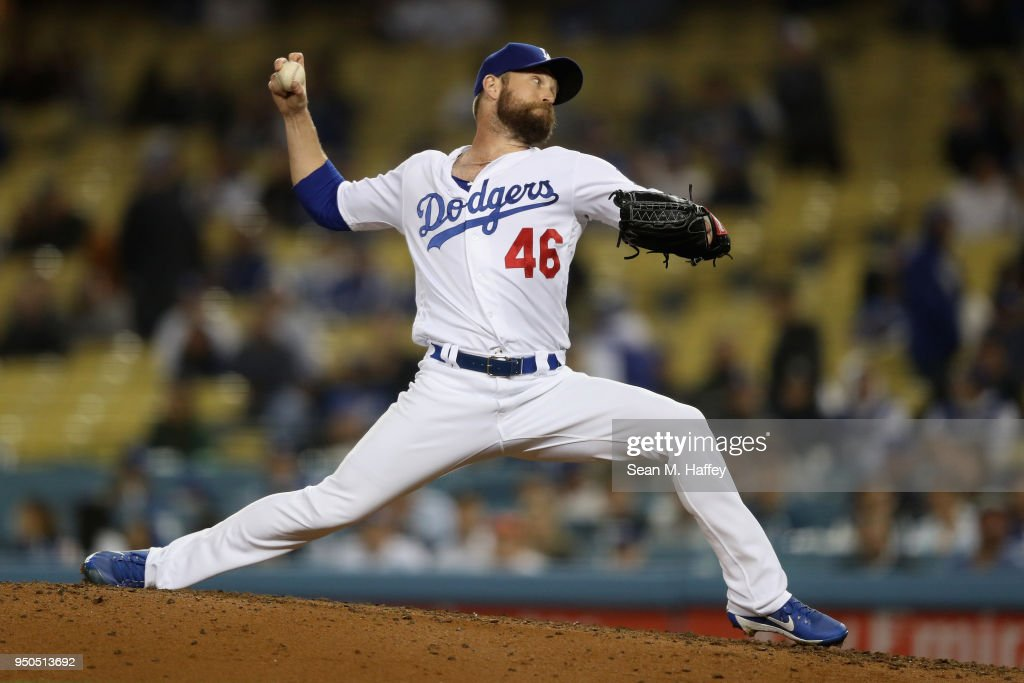 Josh Fields #46 of the Los Angeles Dodgers pitches during the ninth inning of a game against the Miami Marlins at Dodger Stadium on April 23, 2018 in Los Angeles, California.