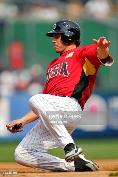 Josh Fields of the U.S.A. Team sildes into third against the World Team during the XM Satellite Radio All-Star Futures Game at PNC Park on July 9,...