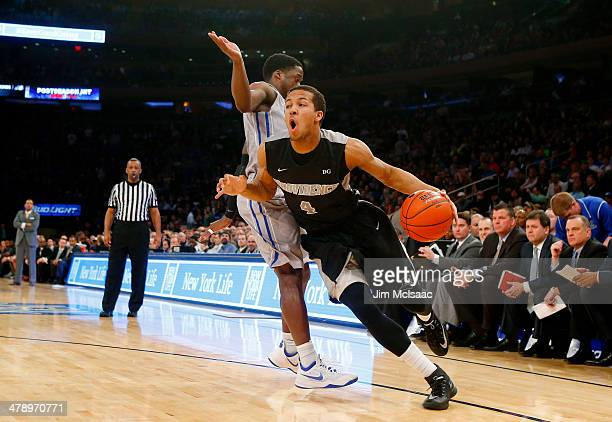 Josh Fortune of the Providence Friars drives against the Creighton Bluejays in the first half during the Championship game of the 2014 Men's Big East...