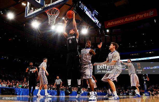 Josh Fortune of the Providence Friars shoots over Austin Chatman of the Creighton Bluejays in the first half during the Championship game of the 2014...