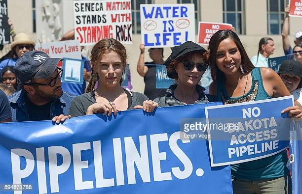 Josh Fox, Riley Keough, Susan Sarandon, and Bobbi Jean Three Lakes attend a rally in support of a lawsuit against The Army Corps Of Engineers to...
