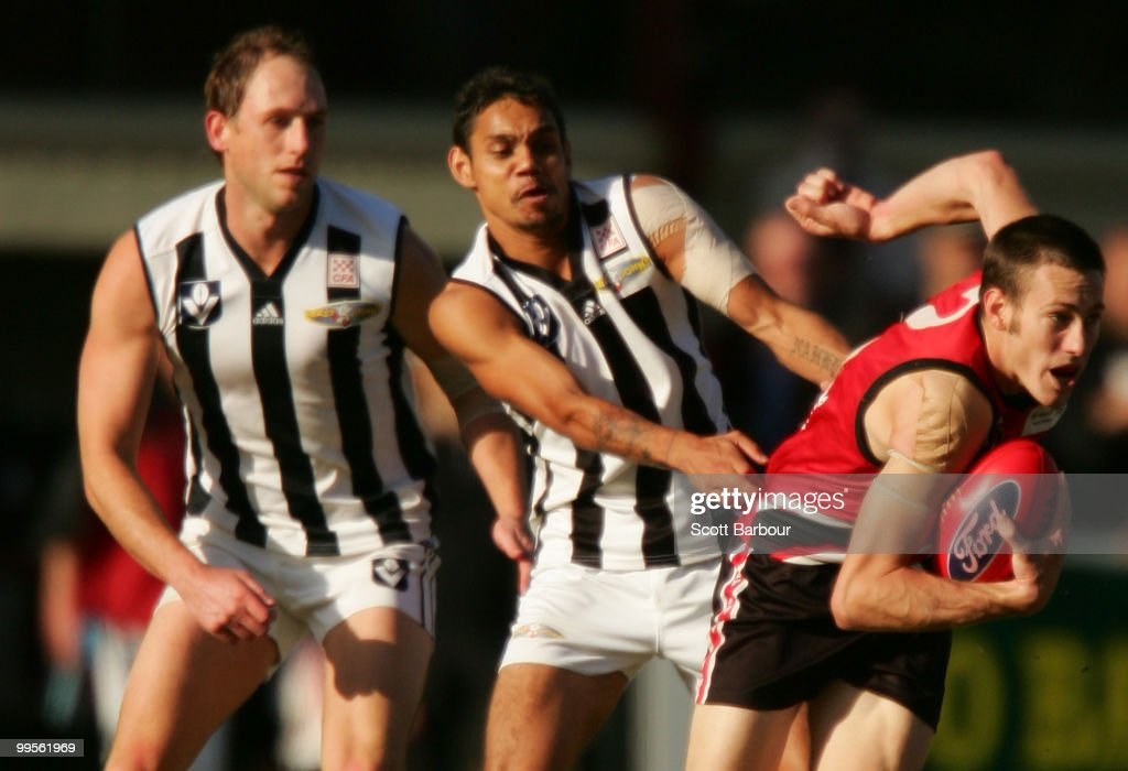 Josh Fraser (L) and Brad Dick (C) of Collingwood tackle Warwick Miller of Frankston during the round six VFL match between Collingwood and Frankston at Frankston Oval on May 15, 2010 in Frankston, Australia.