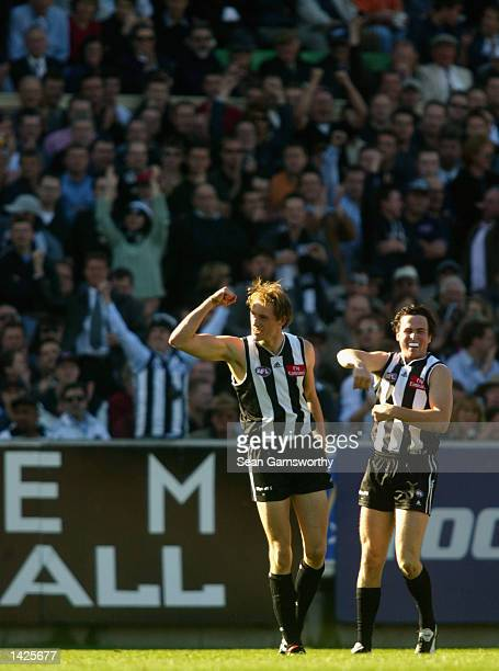 Josh Fraser and Ryan Lonie for Collingwood celebrate a goal during the First AFL Preliminary final match between the Collingwood Magpies and the...