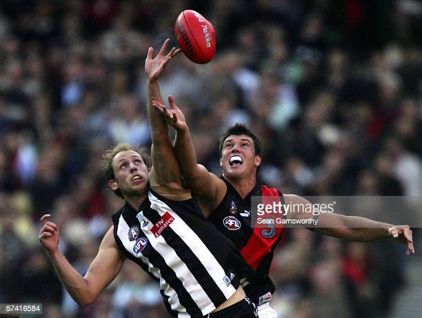 Josh Fraser for Collingwood and David Hille for Essendon in action during the round four AFL match between the Collingwood Magpies and the Essendon...