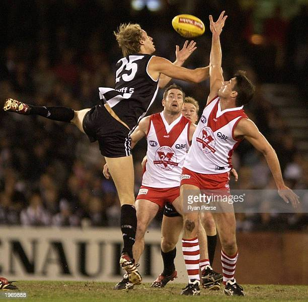 Josh Fraser for Collingwood is in the ruck with Jason Ball for Sydney during the Round six AFL match between the Collingwood Magpies and the Sydney...
