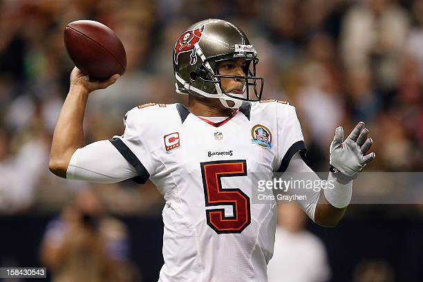 Josh Freeman of the Tampa Bay Buccaneers looks to throw a pass against the New Orleans Saints at the MercedesBenz Superdome on December 16 2012 in...