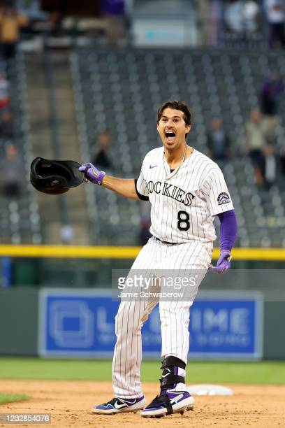 Josh Fuentes of the Colorado Rockies celebrates after hitting a walk-off single against the San Diego Padres during game two of a doubleheader at...