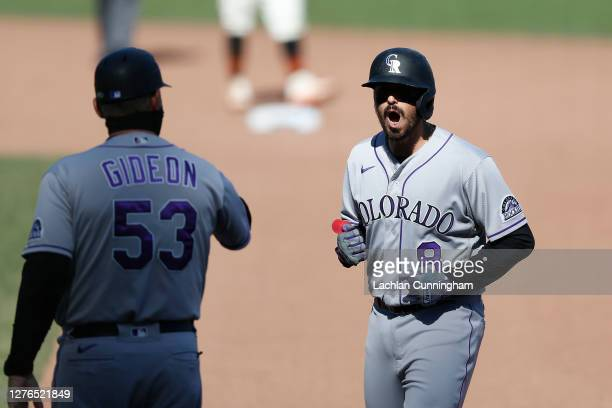 Josh Fuentes of the Colorado Rockies reacts after hitting an RBI single in the top of the seventh inning against the San Francisco Giants at Oracle...