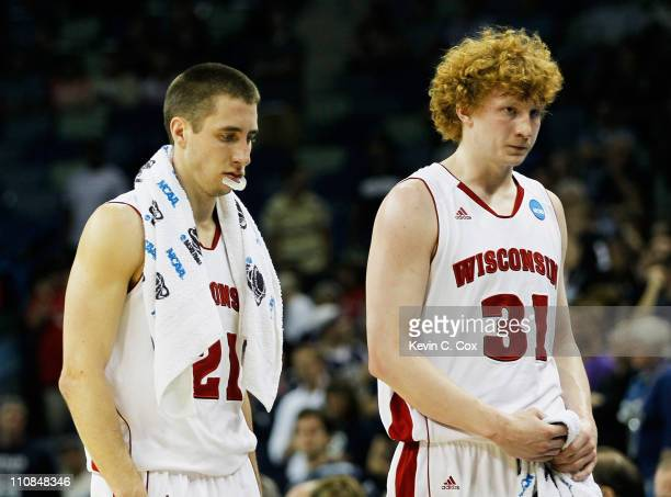 Josh Gasser and Mike Bruesewitz of the Wisconsin Badgers react after their 54 to 61 loss to the Butler Bulldogs during the Southeast regional of the...