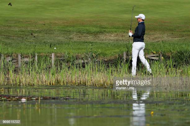 Josh Geary of New Zealand plays his second shot out of the water on the 2nd hole during the first round of the Belgian Knockout at the Rinkven...