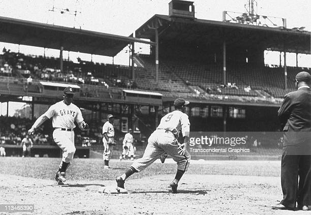 Josh Gibson, catcher for the Negro League Homestead Grays, is approaching first base as he runs out a ground ball in Griffith Stadium circa 1940 in...