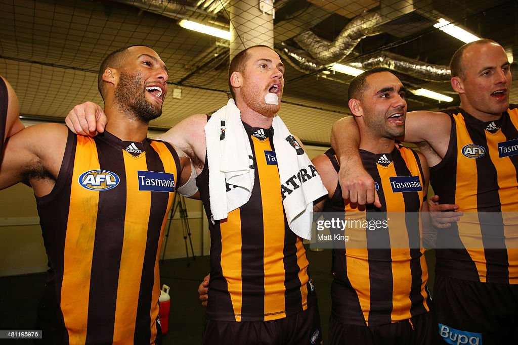 Josh Gibson, Jarryd Roughead and Shaun Burgoyne of the Hawks sing the club song after during the round 16 AFL match between the Sydney Swans and the Hawthorn Hawks at ANZ Stadium on July 18, 2015 in Sydney, Australia.