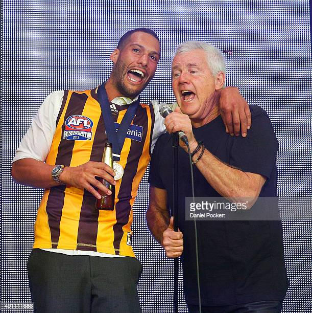Josh Gibson joins Daryl Braithwaite in a performance of Horses during the Hawthorn Hawks AFL Grand Final dinner at Crown Palladium on October 3 2015...
