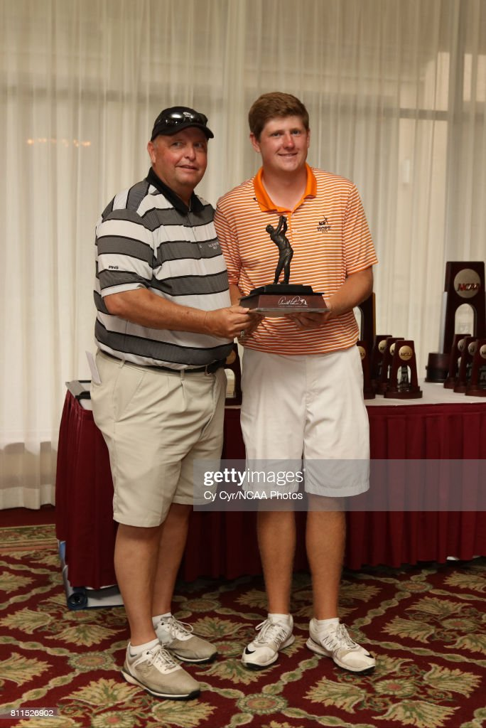 Josh Gibson of Hope College receives a trophy following the Division III Men's Golf Championship held at the Mission Inn Resort and Club on May 19, 2017 in Howey In The Hills, Florida. Gibson won the individual title with a -1 score.