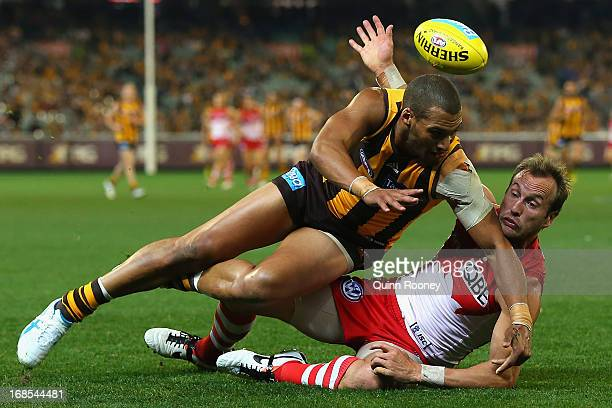 Josh Gibson of the Hawks bumps Jude Bolton of the Swans during the round seven AFL match between the Hawthorn Hawks and the Sydney Swans at Melbourne...