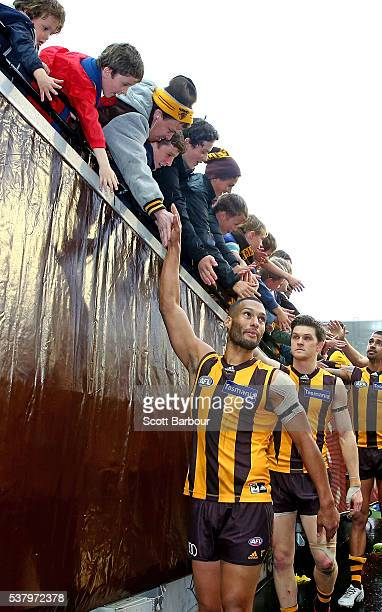 Josh Gibson of the Hawks celebrates with supporters in the crowd after playing his 200th game during the round 11 AFL match between the Hawthorn...