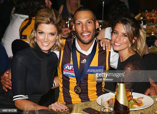 Josh Gibson of the Hawks poses with his girlfriend Renee Bargh and Delta Goodrem as they attend the Hawthorn Hawks AFL Grand Final function at Crown...