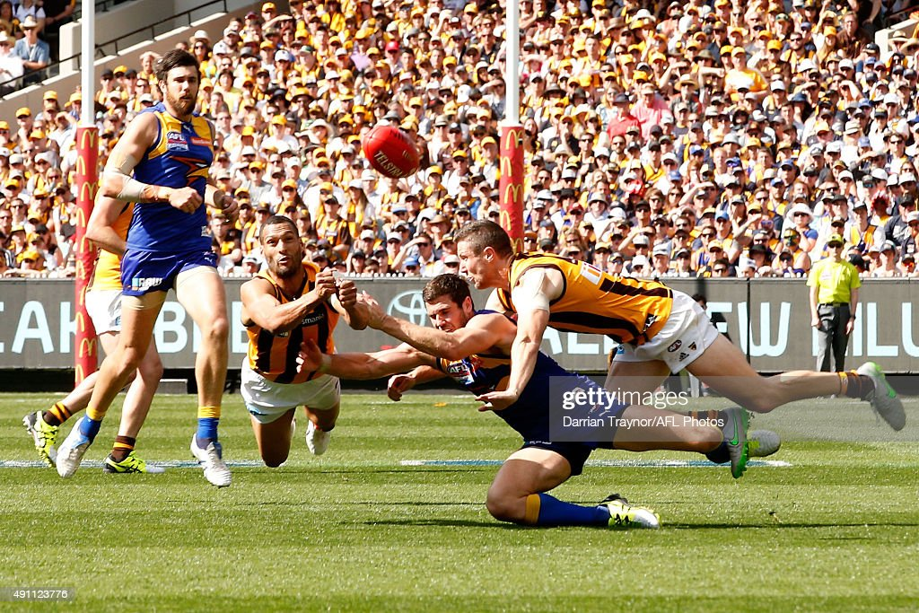 Josh Gibson of the Hawks punches the ball clear of Jack Darling of the Eagles during the 2015 AFL Grand Final match between the Hawthorn Hawks and the West Coast Eagles at Melbourne Cricket Ground on October 3, 2015 in Melbourne, Australia.
