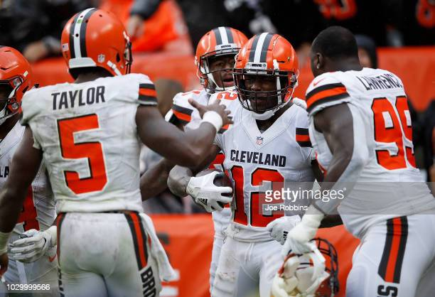Josh Gordon celebrates his touchdown with Tyrod Taylor and Devaroe Lawrence of the Cleveland Browns during the fourth quarter against the Pittsburgh...