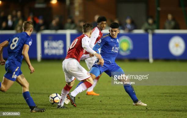 Josh Gordon of Leicester City in action with Vlad Dragomir of Arsenal during the Premier League 2 match between Leicester City and Arsenal at Holmes...