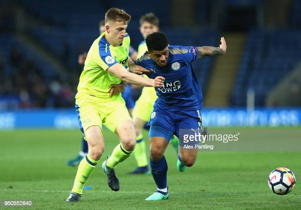 Josh Gordon of Leicester City is tackled by Joe Bateman of Derby County during the Premier league 2 match between Leicester City and Derby County at...