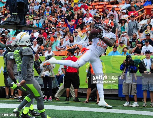 Josh Gordon of the Cleveland Browns and Team Rice makes a catch for a touchdown against Team Sanders during the 2014 Pro Bowl at Aloha Stadium on...