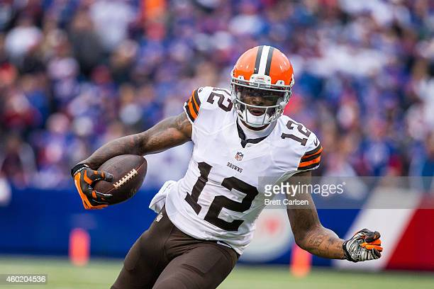 Josh Gordon of the Cleveland Browns carries the ball against the Buffalo Bills on November 30 2014 at Ralph Wilson Stadium in Orchard Park New York...