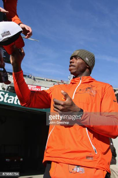 Josh Gordon of the Cleveland Browns signs autographs for the fans before the game against the Cincinnati Bengals at Paul Brown Stadium on November 26...