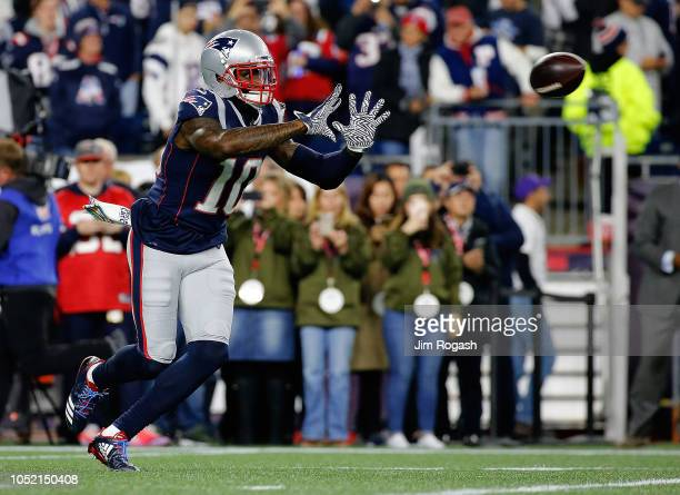 Josh Gordon of the New England Patriots catches a practice pass before a game with the Kansas City Chiefs at Gillette Stadium on October 14 2018 in...