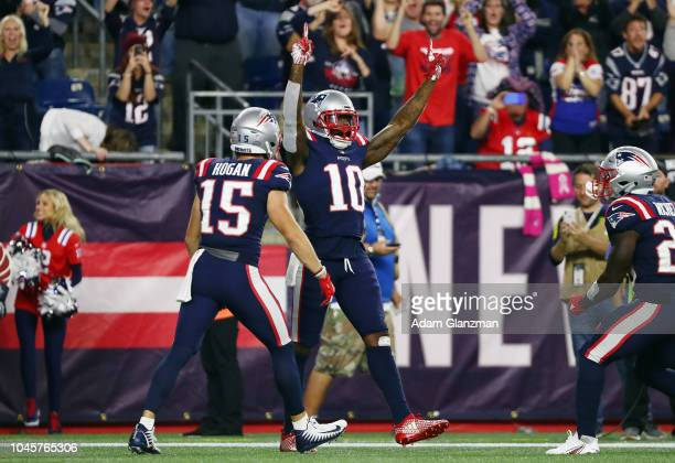 Josh Gordon of the New England Patriots celebrates with Chris Hogan after catching a touchdown pass from Tom Brady during the fourth quarter against...