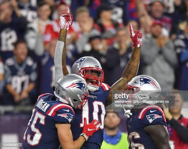 Josh Gordon of the New England Patriots celebrates with Chris Hogan of the New England Patriots and Sony Michel of the New England Patriots after...