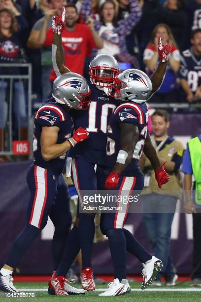 Josh Gordon of the New England Patriots celebrates with teammates after catching a touchdown pass from Tom Brady during the fourth quarter against...