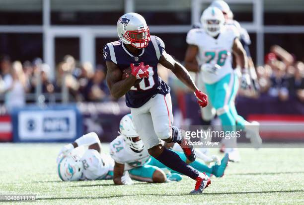 Josh Gordon of the New England Patriots runs with the ball after making a reception during the second half against the Miami Dolphins at Gillette...