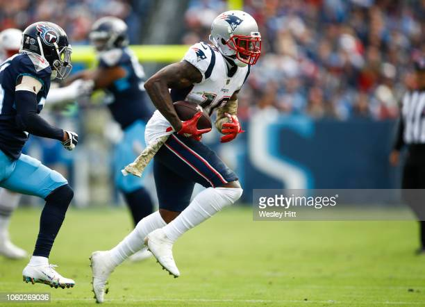 Josh Gordon of the New England Patriots runs with the ball against the Tennessee Titans during the first quarter at Nissan Stadium on November 11...