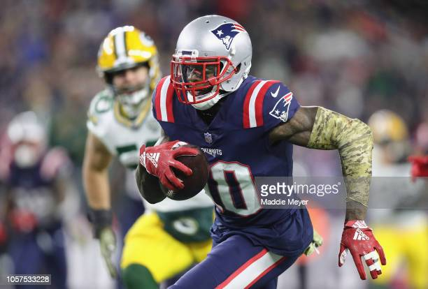 Josh Gordon of the New England Patriots runs with the ball on his way to scoring a 55-yard receiving touchdown during the fourth quarter against the...