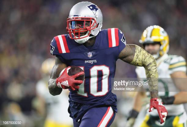 Josh Gordon of the New England Patriots runs with the ball on his way to scoring a 55yard receiving touchdown during the fourth quarter against the...