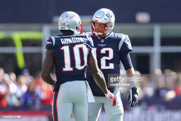 Josh Gordon talks with Tom Brady of the New England Patriots during the second half against the Miami Dolphins at Gillette Stadium on September 30...