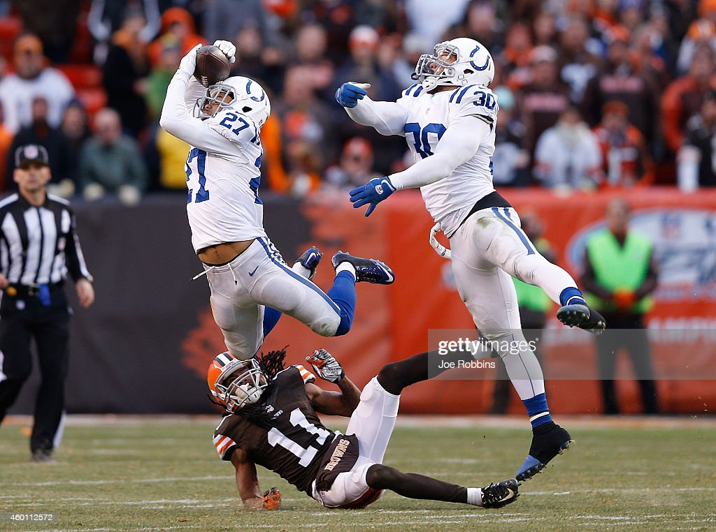 Josh Gordy #27 intercepts a pass intended for Travis Benjamin #11 of the Cleveland Browns alongside LaRon Landry #30 of the Indianapolis Colts during the fourth quarter at FirstEnergy Stadium on December 7, 2014 in Cleveland, Ohio.